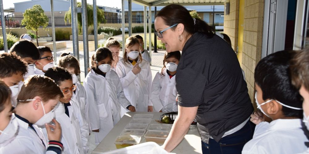 Scientist Rachel Scadding with Carnaby Rise Primary School students.