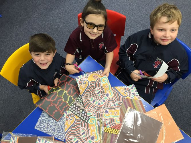 Students Dian Swart, Leshae Itstein and Matthew Healy preparing to make banners for NAIDOC Week.