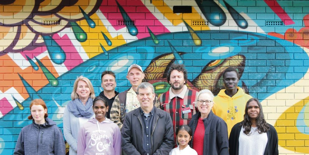 Artist Lawry Halden (wearing baseball cap) with Water Minister Dave Kelly and Mirrabooka MLA Janine Freeman and others involved in creating the Harris Way pump station mural.