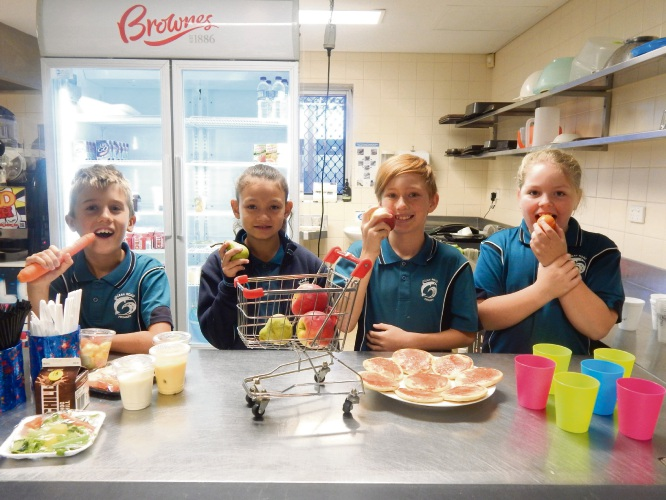 Ocean Road PS environmental Green Team members (from left) Jun, Taylor, Seth and Shae will soon replace single-use packaging as shown on the left with more environmentally friendly options on the right.