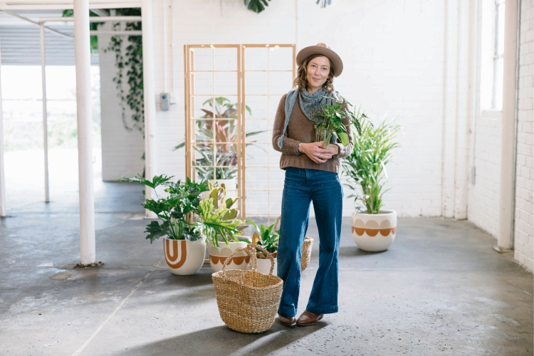 Stackwood's plant expert Claire Greenhill preparing for the plant swap. Picture: Rae Fallon
