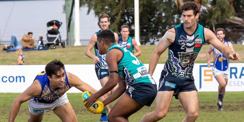 Ryan Bennell attacks the ball while Ben Howlett looks on. Photo: Shazza J Photography.