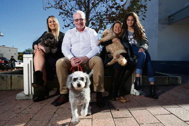 Cr Bianca Sandri and her dog Bentley, Cr David Lagan wiht his dog Georgie, Cr Suzanne Migdale with her dog Buudy and daughter Honey Migdale (11).  Photo: Andrew Ritchie d494416