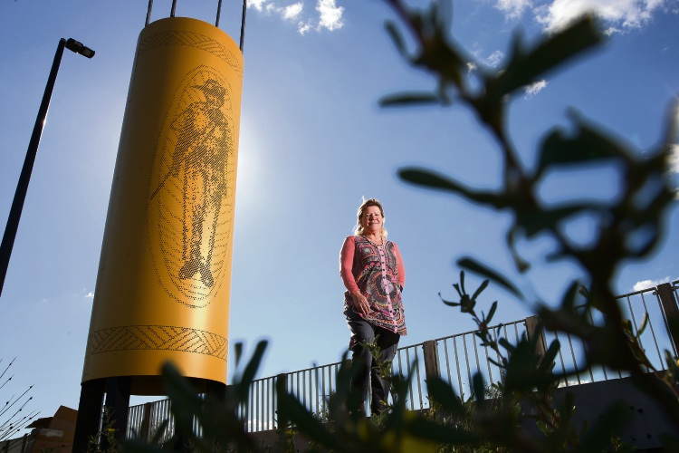 Hamilton Hill artist Sharyn Egan with one of the works, created it to recognise the contributions of Aboriginal people during times of conflict. Picture: Andrew Ritchie. d494317