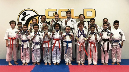Students from Gold Martial Arts in Balcatta with their medals.