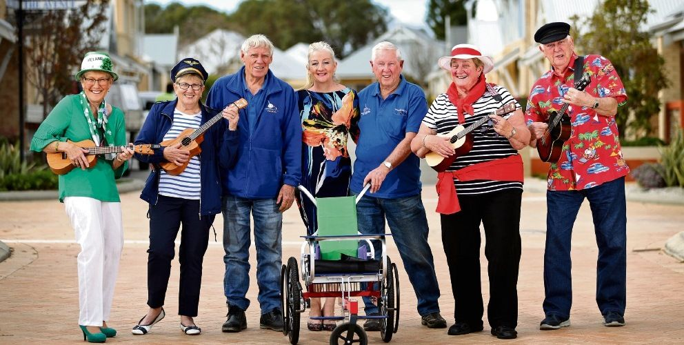 Cambrai Ukulele Band players Margaret Glass, Irene Stirn, Sharon Slimper and Laurie Hodkinson with Wheelchairs for Kids volunteer workshop manager Olly Pickett, Wanneroo Mayor Tracey Roberts and Wheelchairs for Kids volunteer Keith Talbot. Pictures: David Baylis www.communitypix.com.au d494433