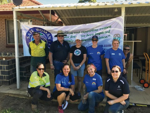 Alcoa volunteers roll up their sleeve to help establish the Safe Woman Safe Family premises.
