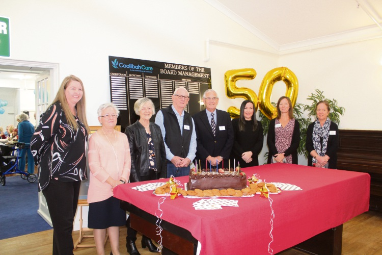 Coolibah Care board members with the 50th anniversary cake.