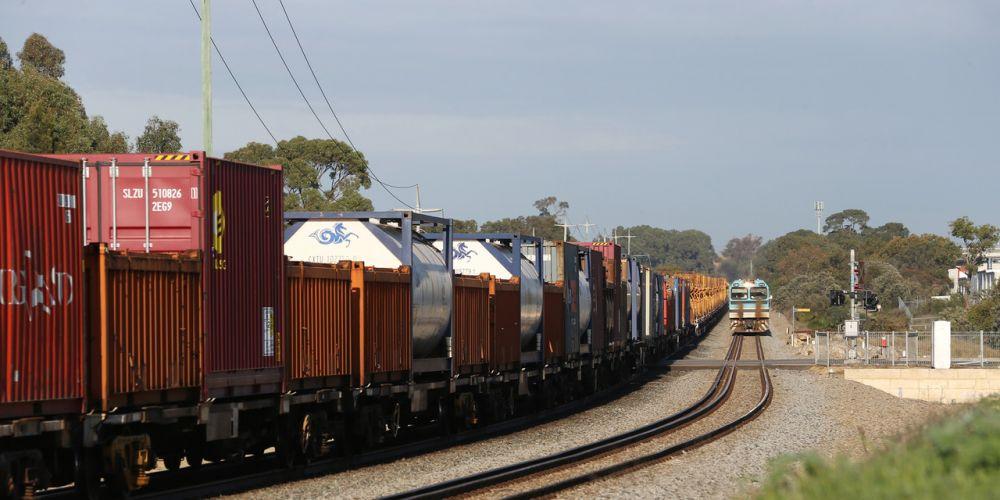 Cargo train crashes into cars   Community News Group