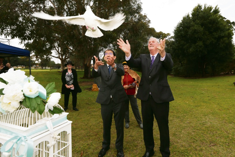 Consul-General of Japan in Perth Mr Toru Suzuki and Mayor Logan Howlett release doves as part of the City of Cockburn's 34th consecutive Hiroshima Day tree planting. Picture: Andrew Ritchie www.communitypix.com.au   d494946