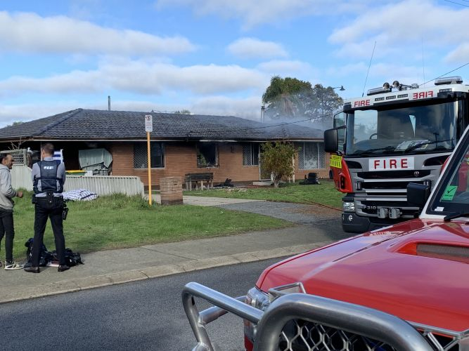 Emergency services at the scene of a house fire in Mandurah. Picture: Vanessa Schmitt