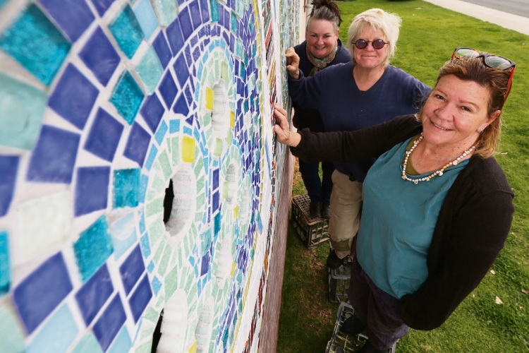 Hamilton Hill artists (L-R) Susan Flavell, Claire Bailey and Sharyn Egan have finished the final touches on their community mosaic. Picture: Andrew Ritchie. d494999
