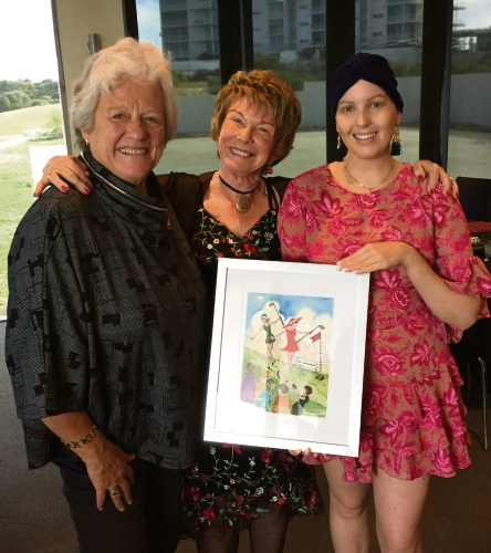 Maureen Payne, Toni Johnson and Leanne Ridgwell with artwork donated by Ms Johnson.