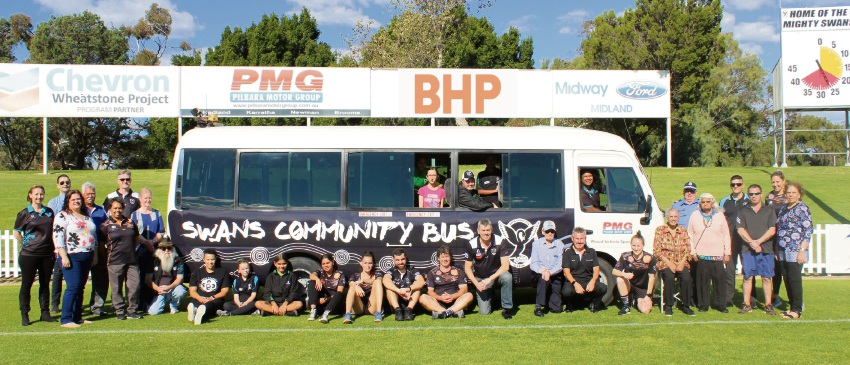 Pilbara Motor Group principal dealer Dave Watson handing over the Swans community bus to club representatives and the club's community partners WA Police, Cyril Jackson Secondary College, Ashfield Primary School, Moorditj Mia, Rise Noongar Elders, Koya Aboriginal Corporation, the WA Football Commission and Swan View High School.