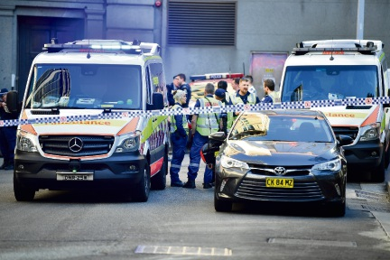 Police are seen during a police operation at the corner of King and York Street in Sydney. Picture: AAP Image/Dean Lewins