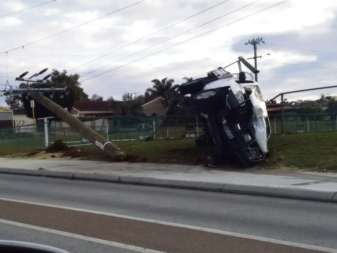 A ute crashed into the power pole on Frederick Street. Picture: Shaun Hayes