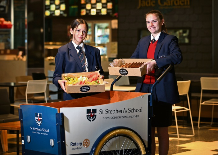 St Stephen's School Year 9 students Jasmine Hollier and Abigail Legge with the food collection trolley at Lakeside Joondalup Shopping City. Picture: David Baylis d494970