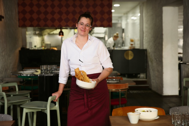 Lions & Tigers head chef Alia Glorie with curry leaf pappadums, turmeric pickles date chutney. Picture: Andrew Ritchie d495134