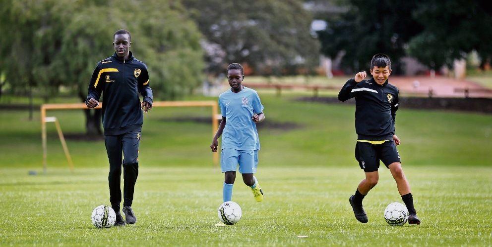 Emmanuel Christian Community School's rising soccer stars Joel Anasmo (14) of Ellenbrook, Thokbeny Makol (12) of Ballajura and Mark Cinzah (12) of Mirrabooka. Pictures: David Baylis www.communitypix.com.au d495124