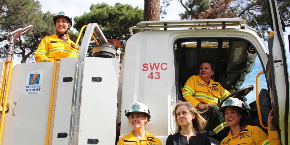 Women's Interests Minister Simone McGurk with the women who work in fire management. Picture: Nadia Budihardjo