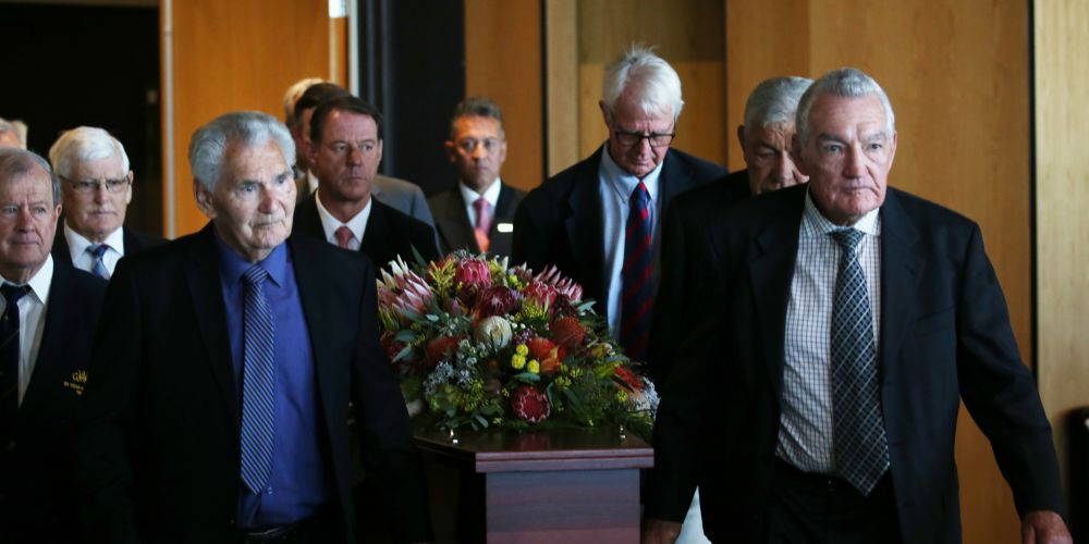 Pallbearers carry the coffin of WA footy legend Graham 'Polly' Farmer. Andrew Ritchie