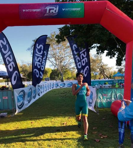 Rahul Jegatheva (17) crossing the finish line at the Australian Age Group Aquathlon Championship.