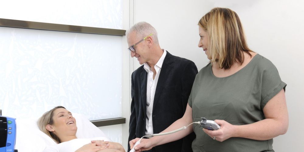 First time mother-to-be Nicole Ryan with JHC head of obstetrics and gynaecology Dr Cliff Neppe and Stork founder Sarah Johnston. Picture: Chris Kershaw