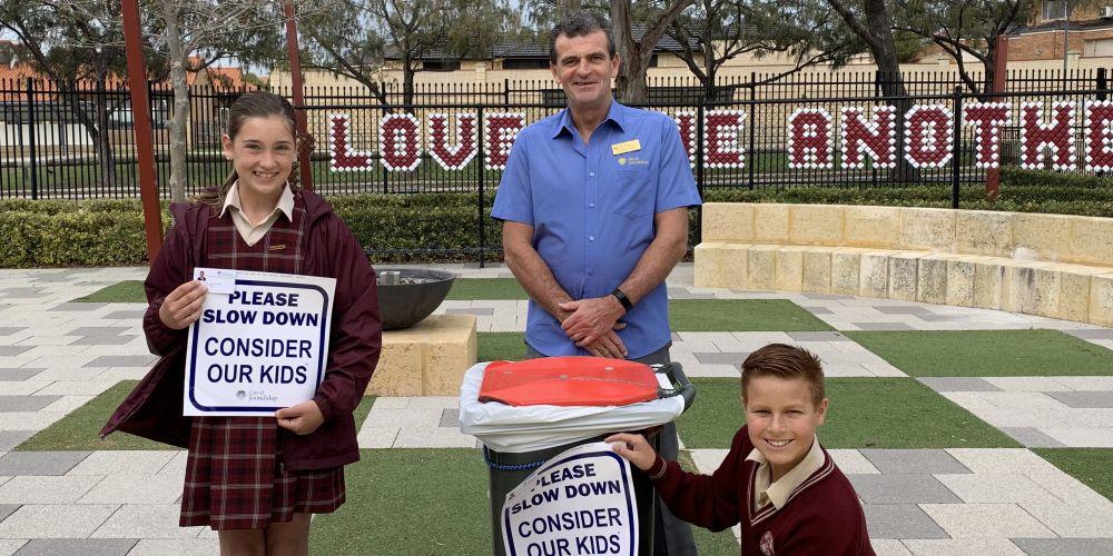 St Simon Peter Catholic Primary School students Charlotte Hughes and Mitchell Newton with Cr Nige Jones.