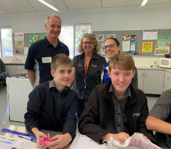Pinjarra Alumina Refinery chemical services manager Richard Yeates with Year 8 Coodanup College students Jack White (left) and Lachie Campbell (right), teacher Christine Bennett (center), and UWA's Bronwen Veale during the 'Megalodon' maths session.