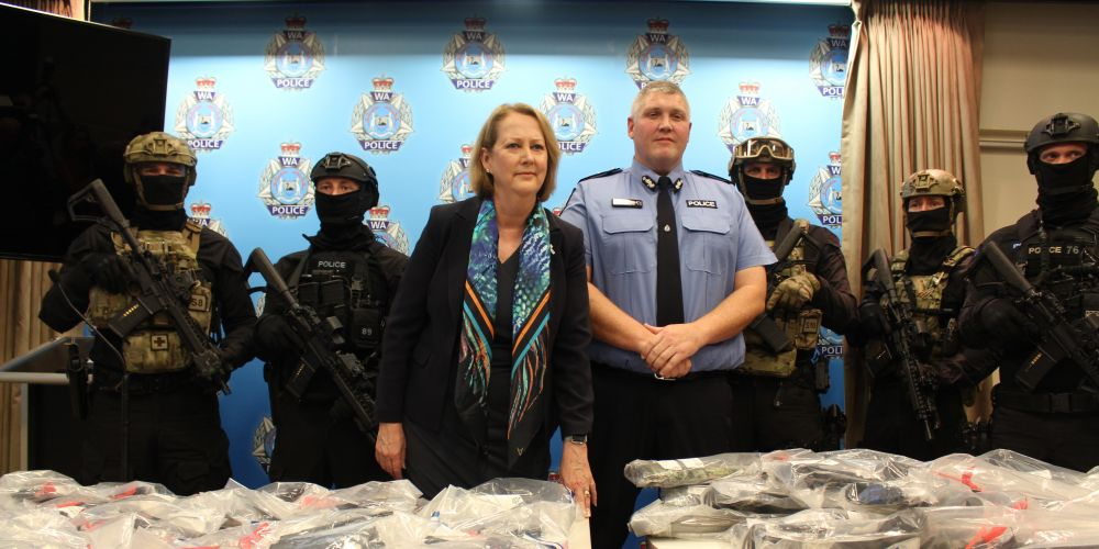 Police Minister Michelle Roberts and Deputy Commissioner Col Branch with the recovered guns. Picture: Nadia Budihardjo