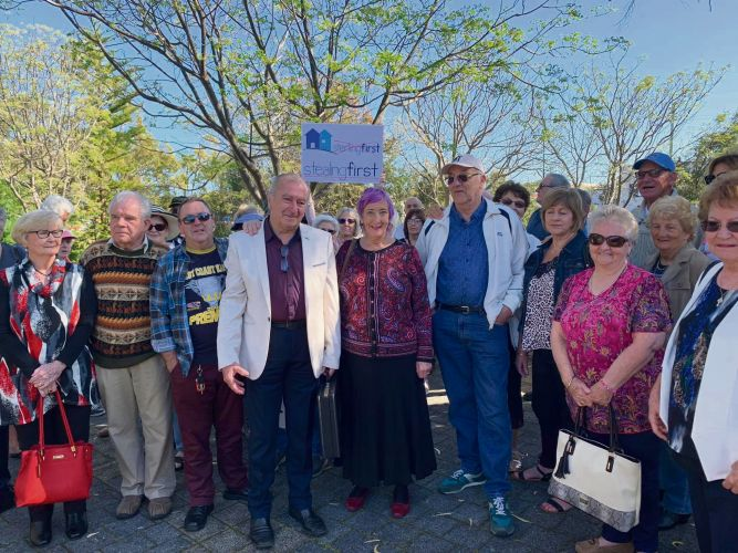Silver Sands residents Alex Tufecic and Leonie Yates with supporters outside Mandurah Magistrates Court.