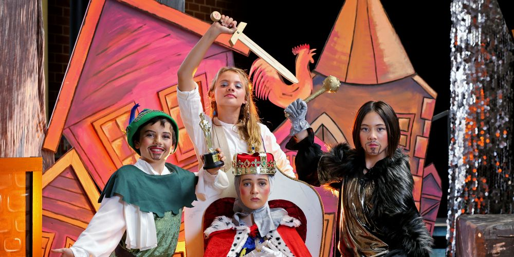 STANDING L-R: Sam Gallagher (11) of Cottesloe as Robin Hood, Verity Khan (12) of Cottesloe as Maid Marion and Grace Powell (12) of Cottesloe as Sheriff of Nottingham.  SEATED: Lila Jackson (11) of Cottesloe as King John. Photo: Andrew Ritchie.