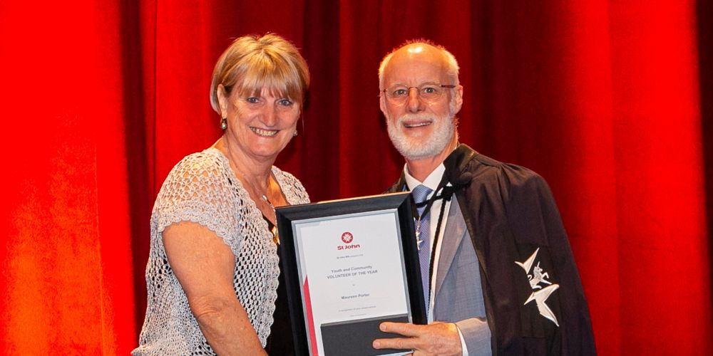 Maureen Porter of Kingsley with St John WA chairman Shayne Leslie.