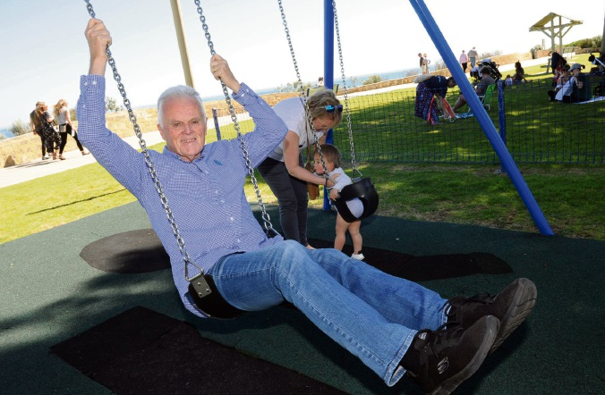 Mayor Phil Angers swings into revamping Cottesloe's playgrounds and parks, with Alison Hutt and grandson Lachlan. Picture: Jon Bassett.