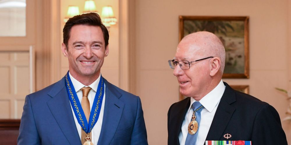 Hugh Jackman receives his Order of Australia medal from Governor-General David Hurley. Photo: Getty