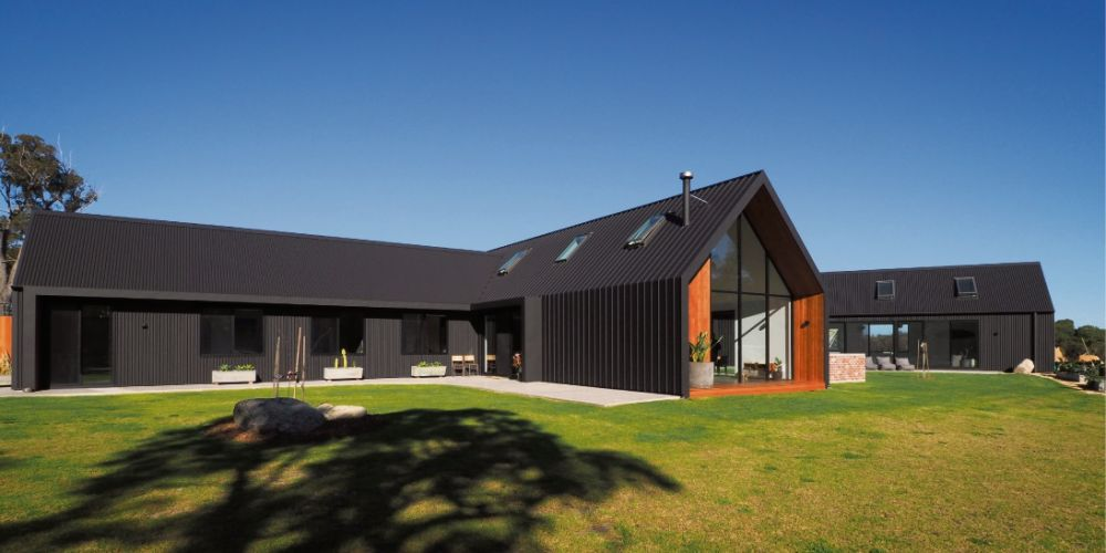 The metal sheeting used on the roof was bent down to form the walls in this Scandinavian-inspired Albany home.