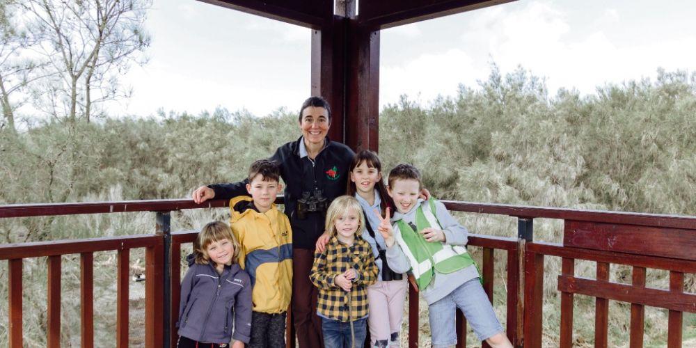 Sarah Way with kids exploring nature. Photo by J. Duffus Photography.
