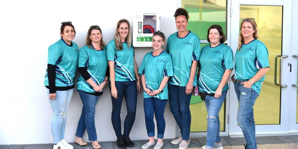 Yanchep Little Athletics Club committee members with the defibrillator. Picture: Toby Curtis