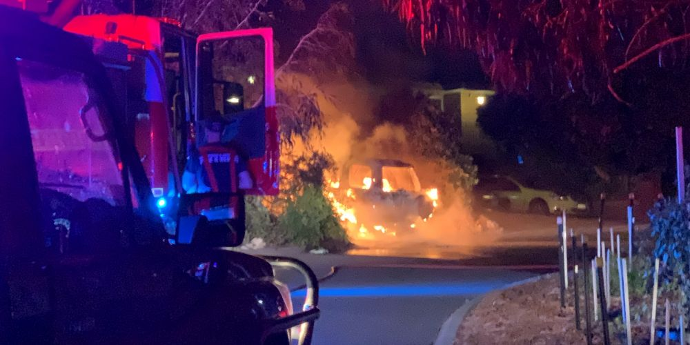 DFES officers attended the deliberately lit car fire. Picture: Anton La Macchia