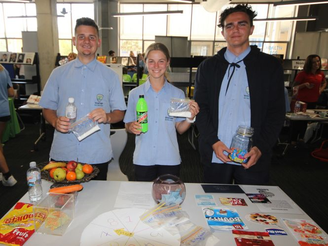 Year 11 students Damion Holmes, Summer Pollock and Xavien Tata with their diabetes dispay.