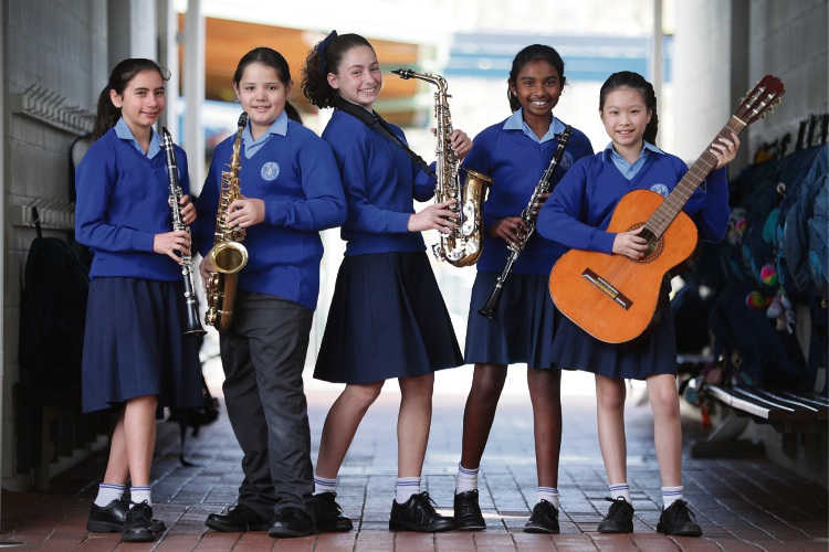 Sienna Giuffre (y6), Levi Munn (y5), Isabella Ghobrial (y6), Shoshana Ramanathan (y6) and Chloe Chang (y6), Orana Catholic Primary School has excelled at the recent Performing Arts Festival winning four shields for...piano, band, saxophone trio and clarinet duet Picture: Andrew Ritchie www.communitypix.com.au   d495935