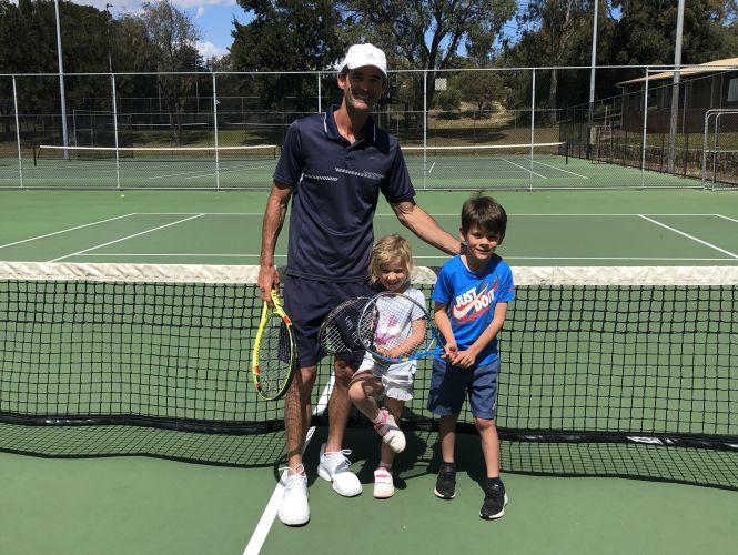 Ocean Ridge Tennis Club coach Glen Popovsky with his children Soraya (4) and Hunter (6).