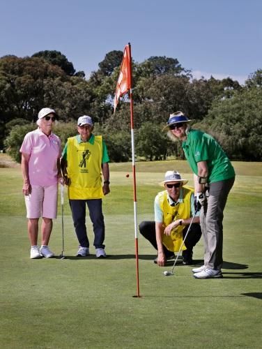 Deanna Minciullo with husband and caddie Clarrie Minciullo watch on as Jenny McCallum, with husband and caddie Ian McCallum, putts. Picture: David Baylis d495716