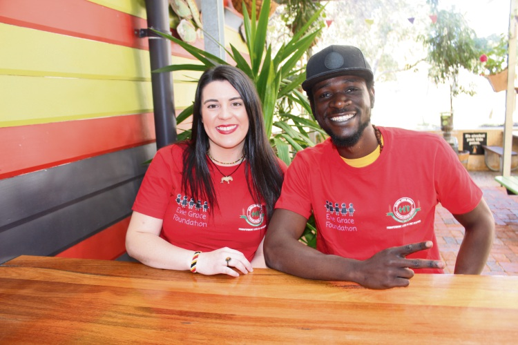 Evie Grace Foundation founder Maddi Kent with musician Macmillan Muyola, stage name Afroking.