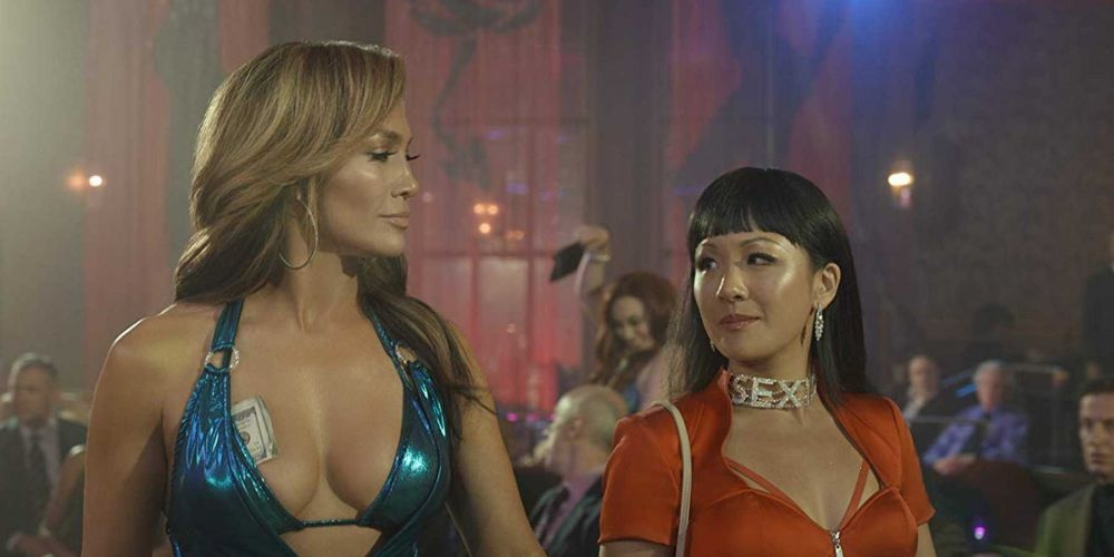 Jennifer Lopez as Ramona and Constance Wu as Destiny in Hustlers (2019).