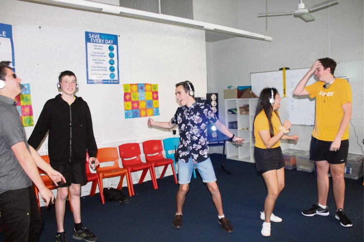 Coodanup College students enjoying a silent disco for R U OK Day.