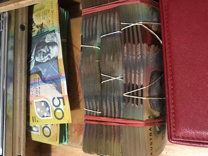 Police allegedly found $35k cash found in concealed drawer compartment. Picture: Australian Federal Police