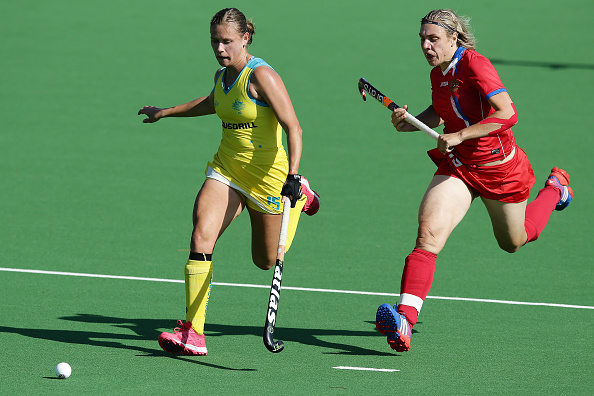 Kaitlin Nobbs of the Hockeyroos and Bogdana Sadovaia of Russia chase the ball. Picture: Will Russell/Getty Images