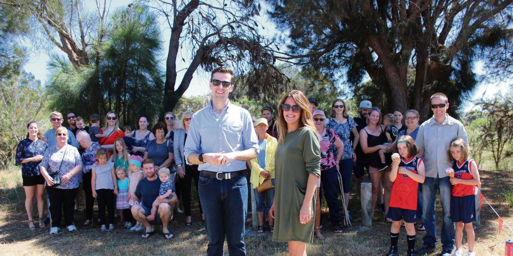 Dawesville MLA Zak Kirkup and Little Aussie Café owner Jo Cooper with residents calling for an enclosed park in Erskine.