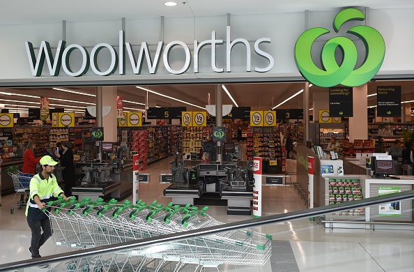 A worker pushes shopping trollys at a Woolworths store. Picture: Getty